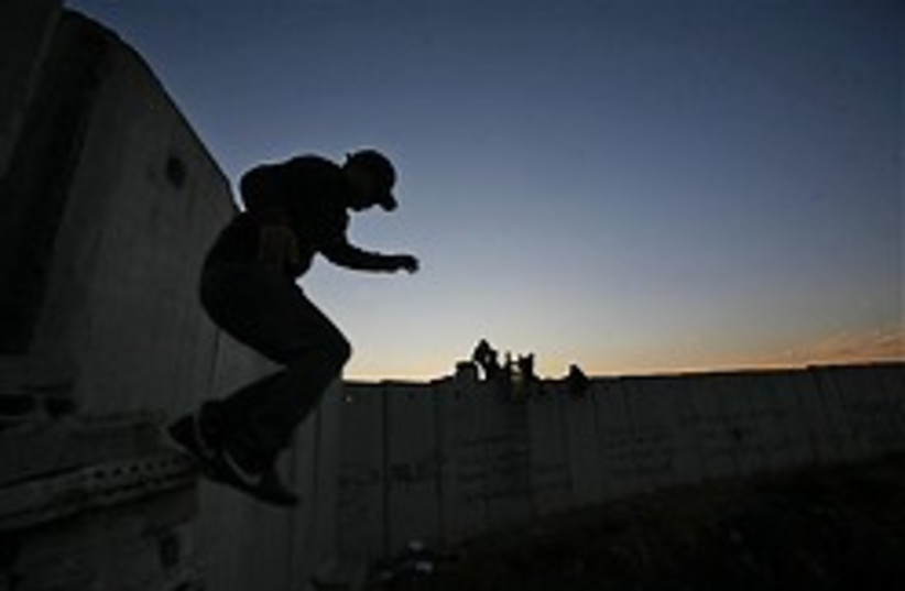 man jumps off security barrier 248.88 (photo credit: AP)