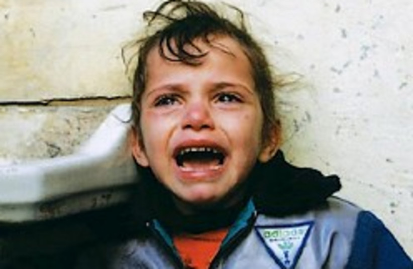 palestinian girl crying 248 ap (photo credit: AP)