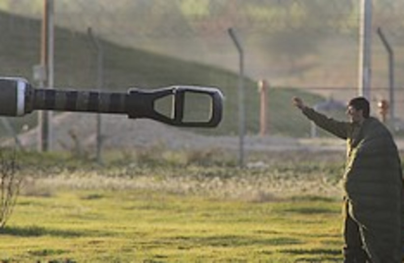 IDF soldier directs artillery 248.88  (photo credit: AP)