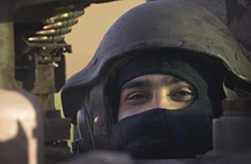 idf soldier armored vehicle gaza 248.88 (photo credit: AP)