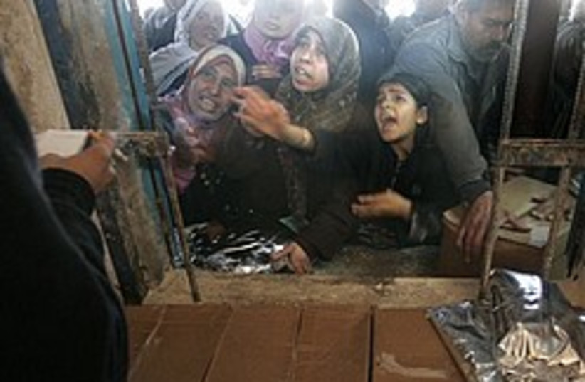 Palestinian receive food aid 248.88 (photo credit: AP [file])