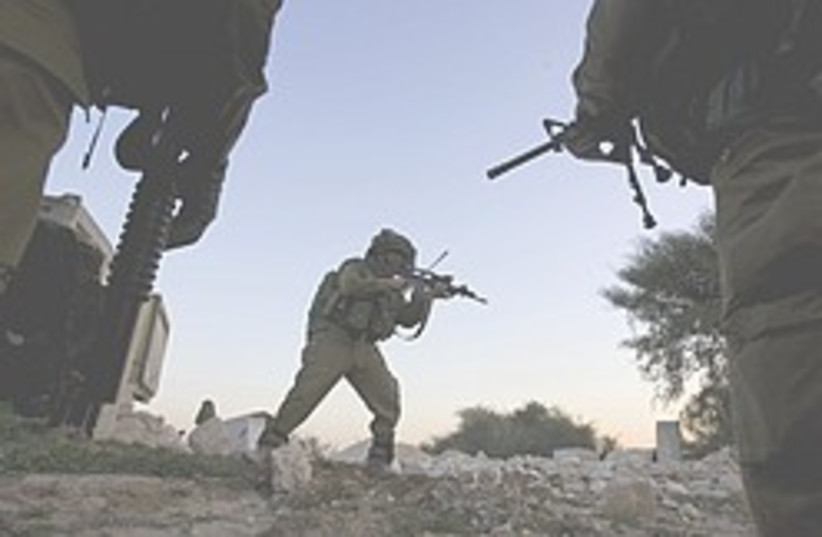 IDF reservist  Gaza border 248.88 (photo credit: AP)