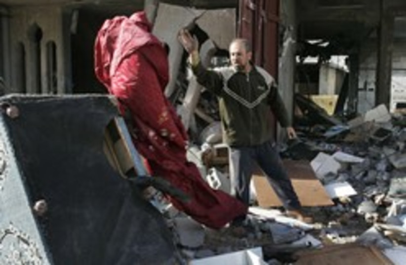 gazan searches bombed house 248.88ap (photo credit: AP)