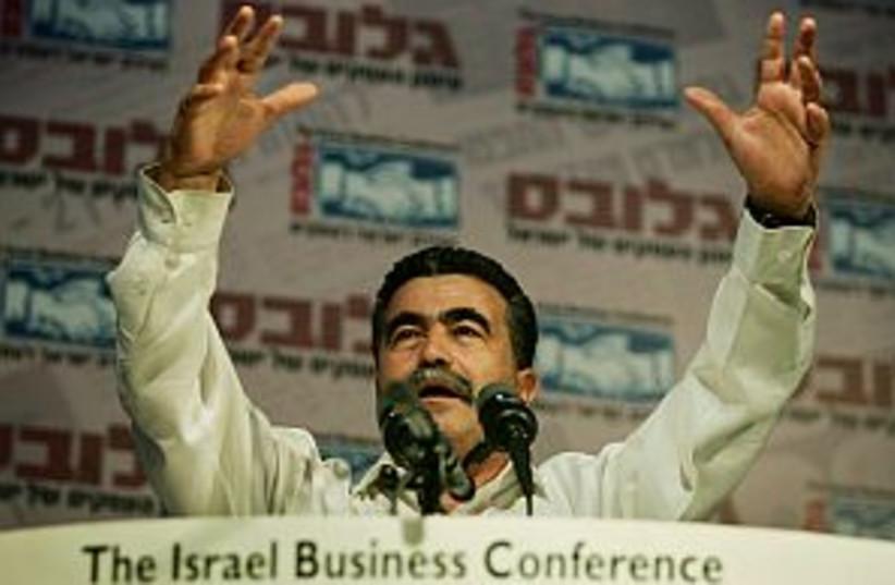peretz arms raised 298 (photo credit: AP)