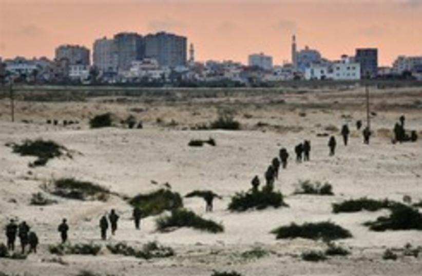 idf soldiers gaza walking beach 248.88ap (photo credit: AP [file])