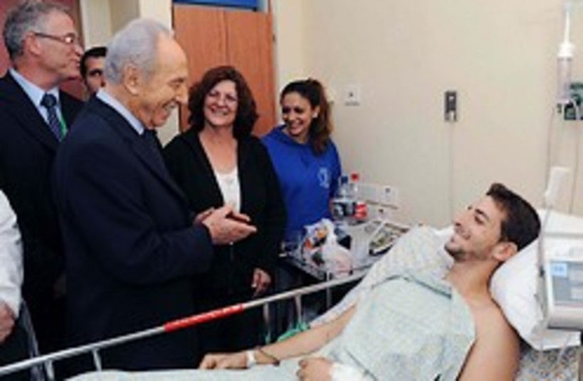 peres wounded soldier 248.88 (photo credit: GPO)