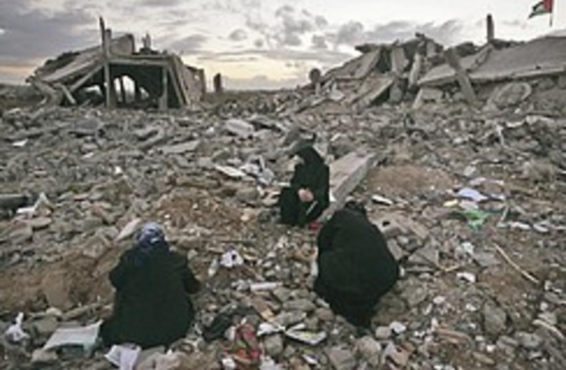 Palestinian women sit in rubble 248.88 (photo credit: AP)