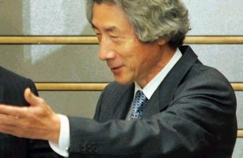 koizumi 298.88 (photo credit: Associated Press)