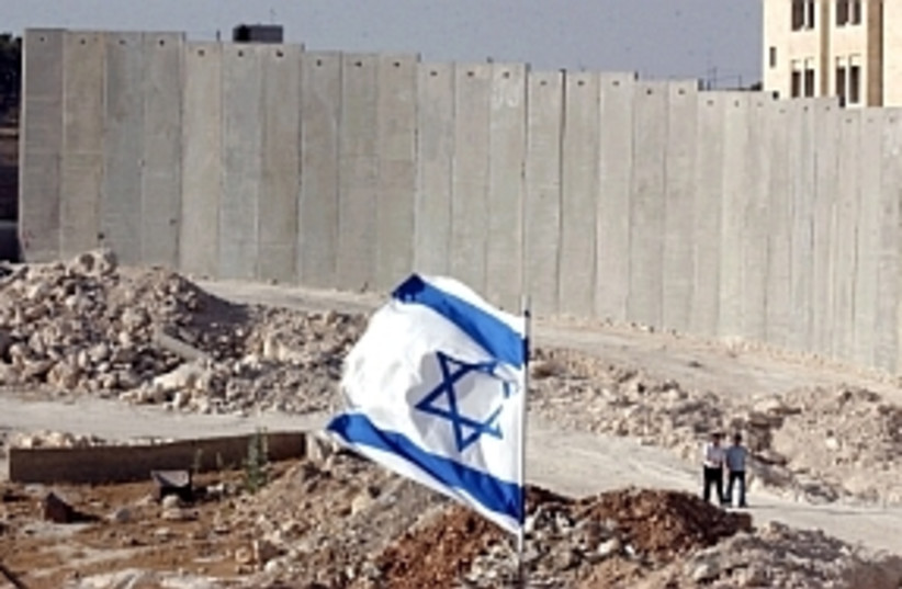 fence with flag 298  (photo credit: Ariel Jerozolimski [file])