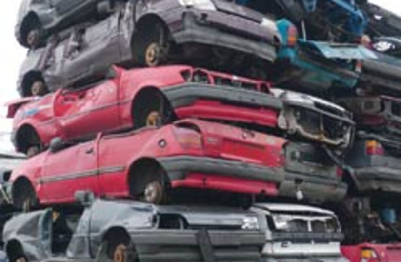 crushed cars 88 248 (photo credit: )