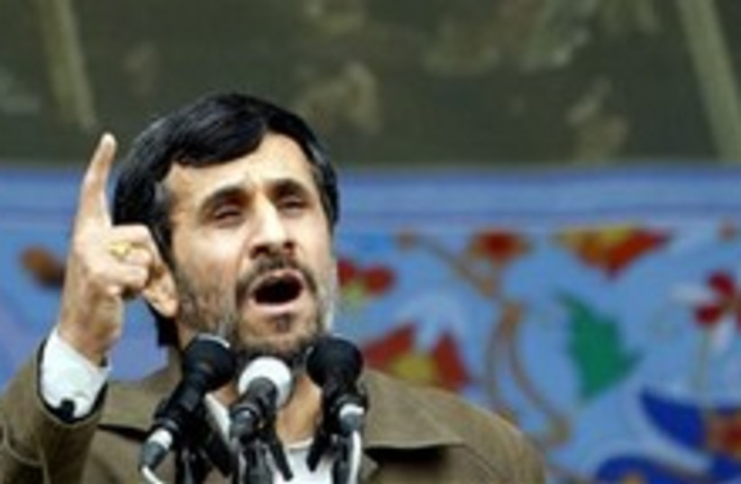 ahmadinejad waves finger around 248 88 (photo credit: AP [file])