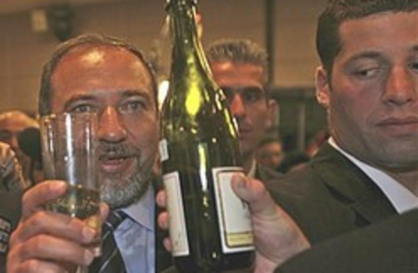 lieberman gets drunk 248.88 (photo credit: AP)