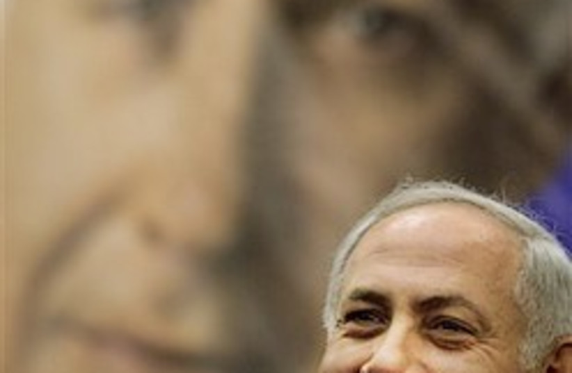 netanyahu with poster great 248.88  (photo credit: AP)