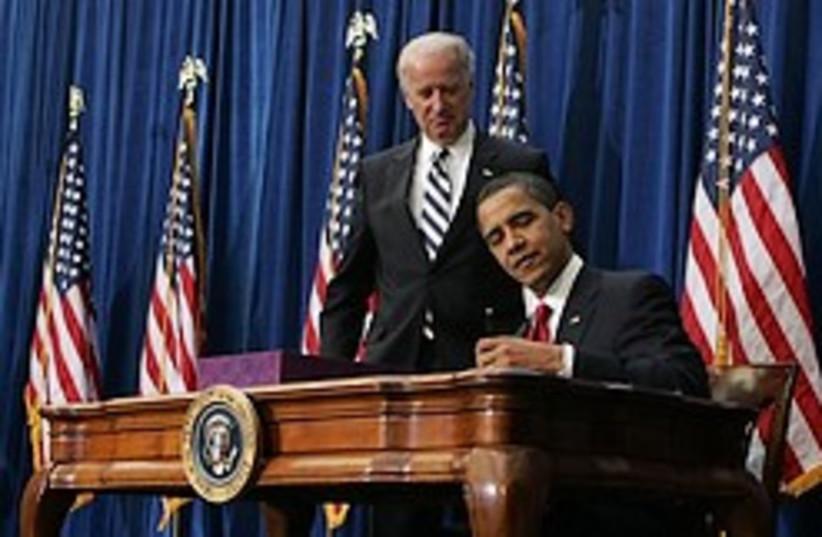 obama signs stimulus bill w biden 248 ap (photo credit: AP)