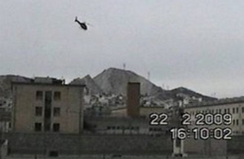 helicopter escape 248.88 ap (photo credit: AP)