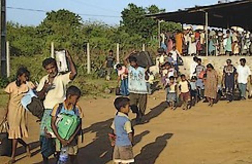 sri lankans flee 248.88 (photo credit: AP)