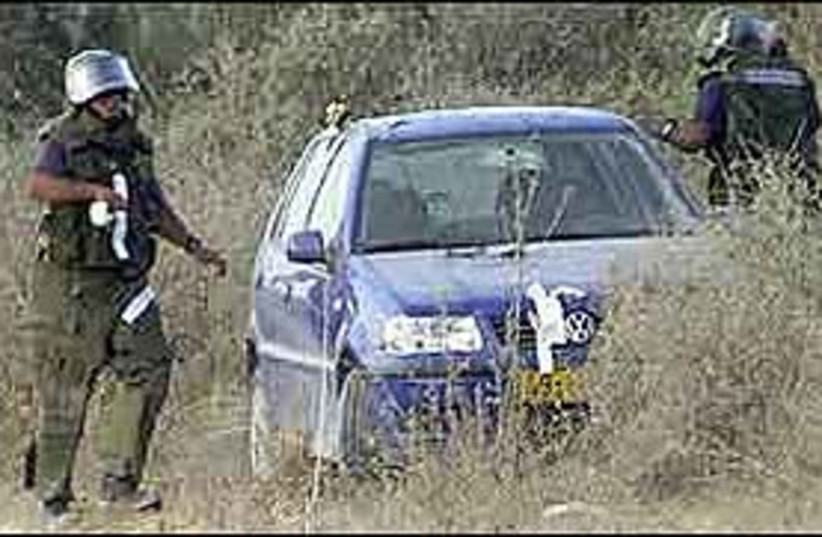 forces surround car 298. (photo credit: AP [file])
