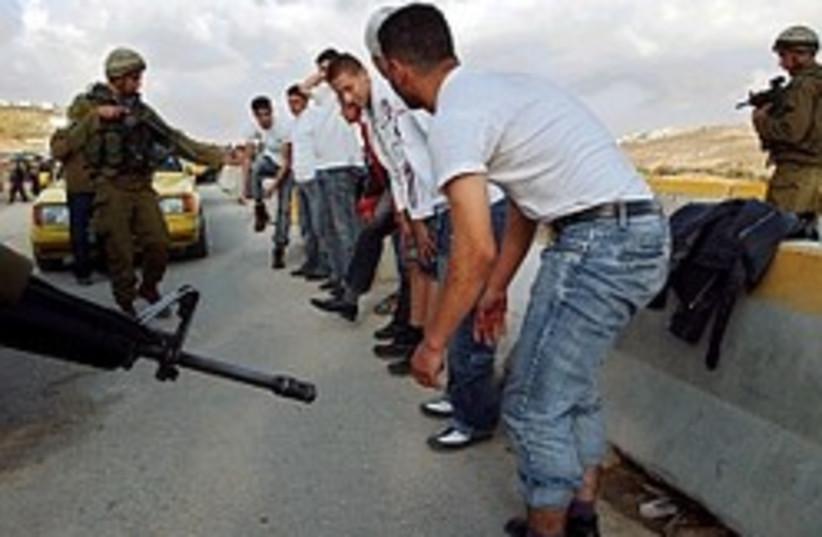 hawara checking palestinians 248 88 (photo credit: AP [file])