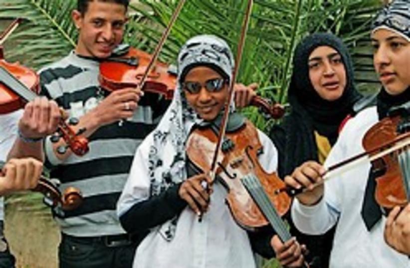Palestinians sing 4 holocaust survivors (photo credit: )