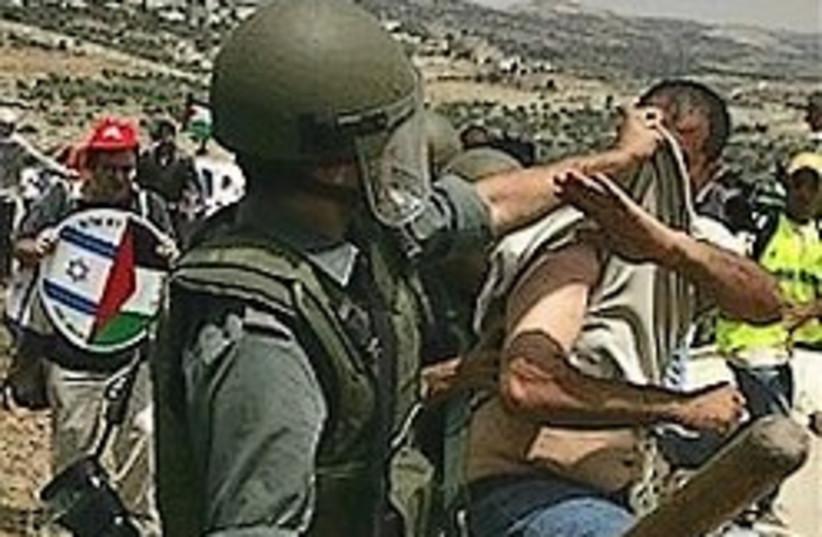 bilin soldier protester scuffle 248 88 a (photo credit: AP [file])