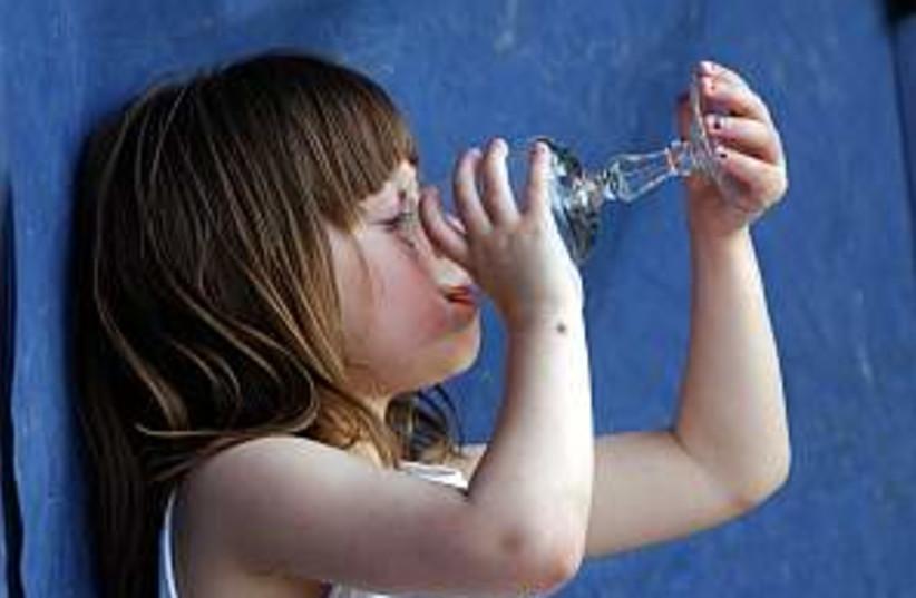 kid drinking water 298.8 (photo credit: Ariel Jerozolimski)