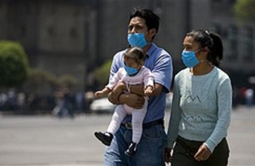 flu masked family 248.88 (photo credit: )