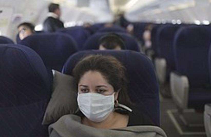 swine flu plane 248.88 (photo credit: AP)