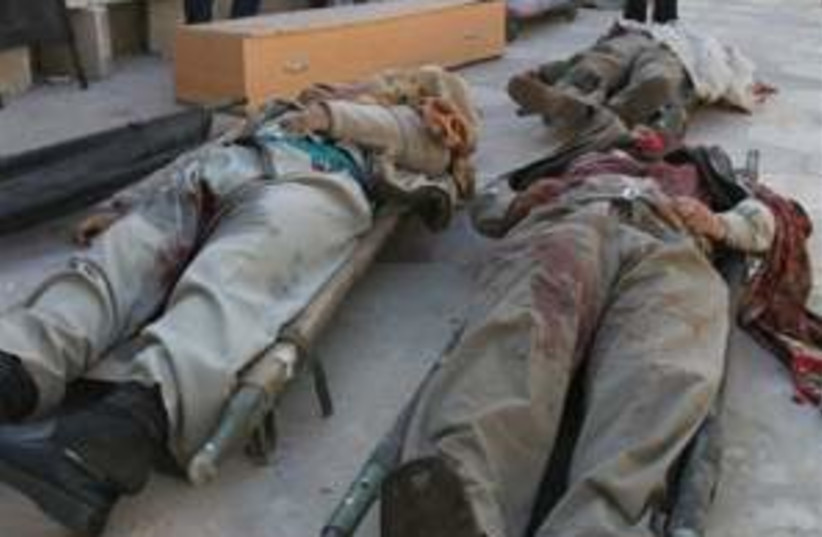 baghdad bodies 88.298ap (photo credit: AP)