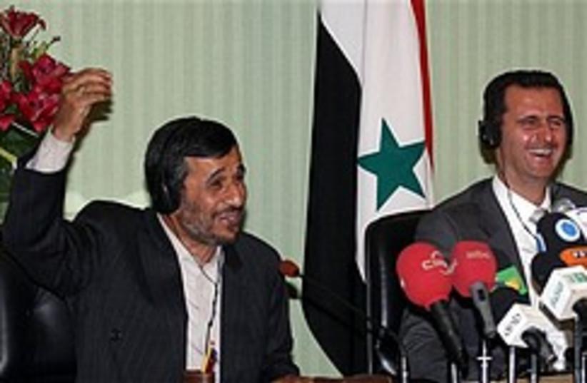 ahmadinejad and assad 248.88 (photo credit: AP)