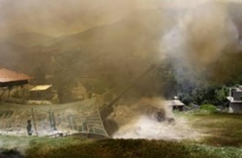 pakistani army fire artillery 248 88 (photo credit: AP)