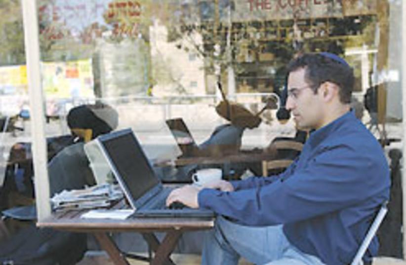 man using laptop 88 248 (photo credit: Ariel Jerozolimski)