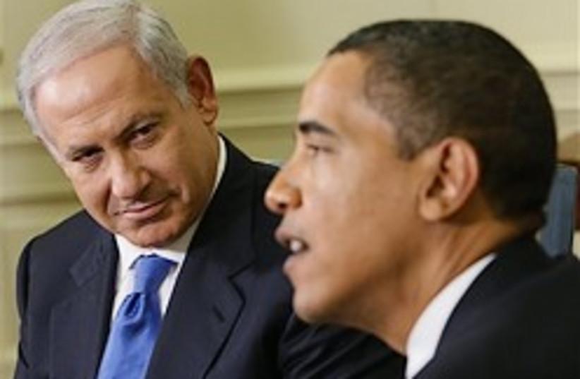 netanyahu listens to obama 248.88 (photo credit: AP)
