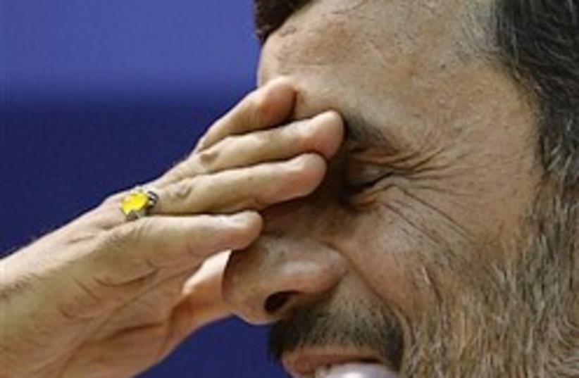 Ahmadinejad hand on eyes 248.88 (photo credit: AP)