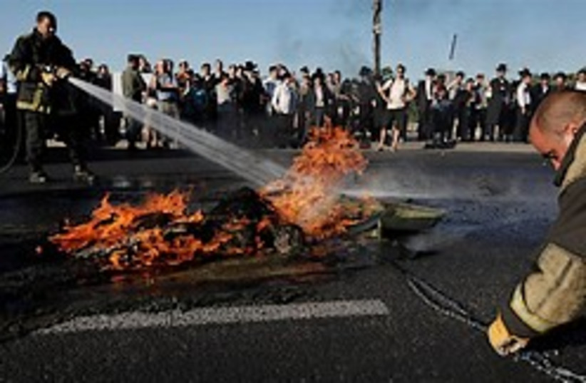 settlers riot fire 248.88 (photo credit: AP)