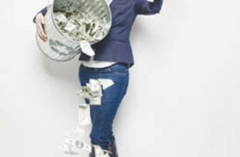 lady with money 88 248 (photo credit: Planet Green)