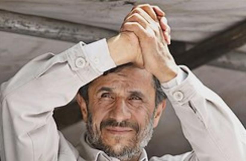 ahmadinejad hands together 248.88 (photo credit: AP)