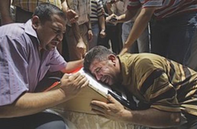 Obeidi funeral iraq 248.88 (photo credit: AP)
