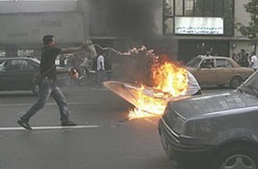 Iran riots fire 248.88 (photo credit: AP)