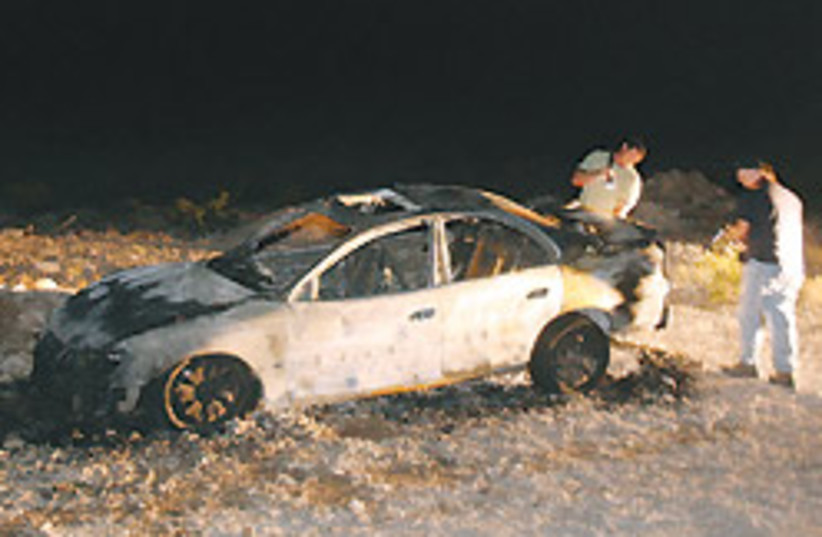 burnt car 88 248 (photo credit: )