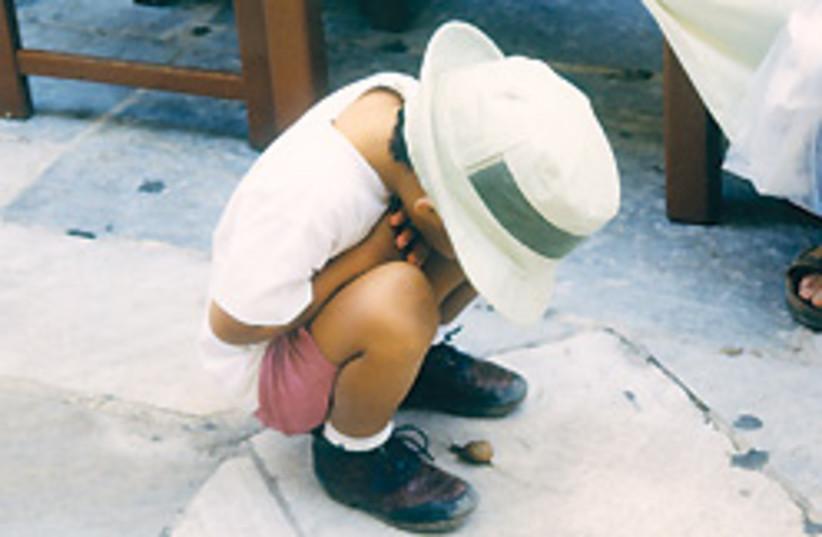 child with hat 88 248 (photo credit: Collin Elliot)