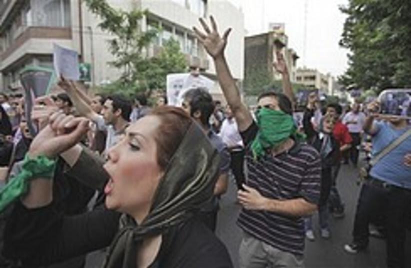 Iran protest woman shouts 248.88 (photo credit: AP)