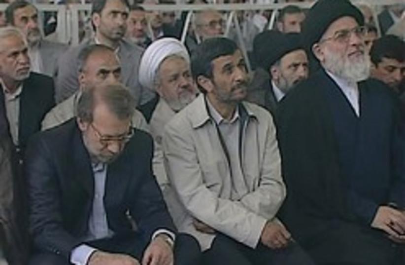 ahmadinejad listening to khamenei 248.88 (photo credit: AP)
