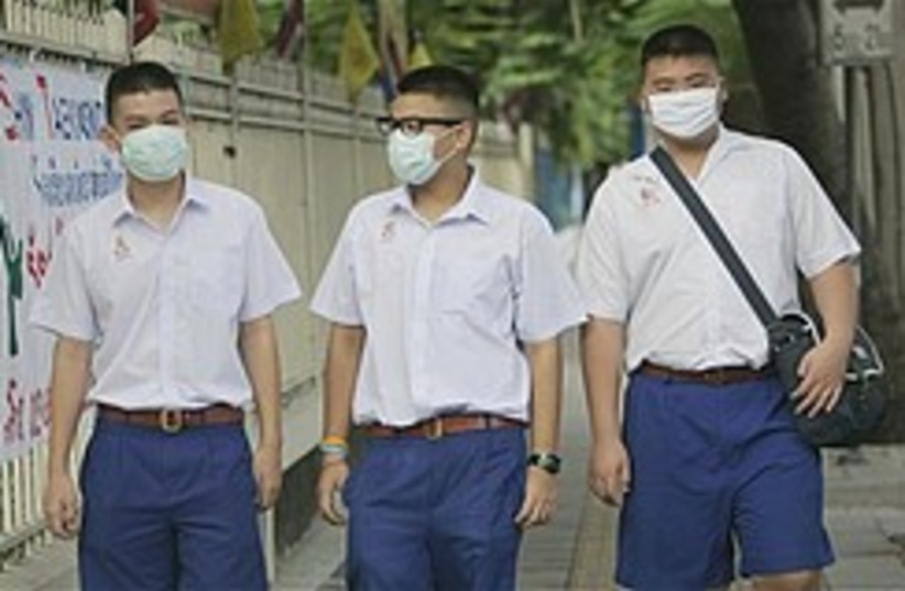 Thai swine flu 284.88 (photo credit: AP)