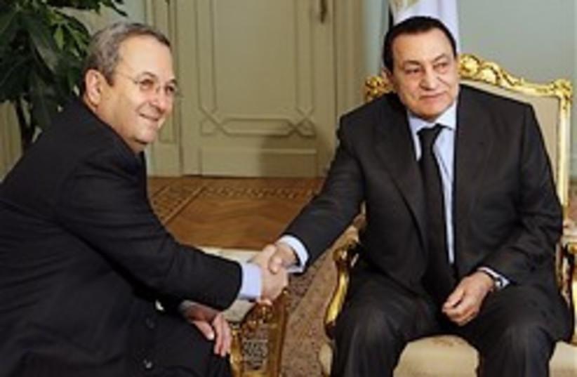 mubarak shakes hands with Barak (photo credit: )