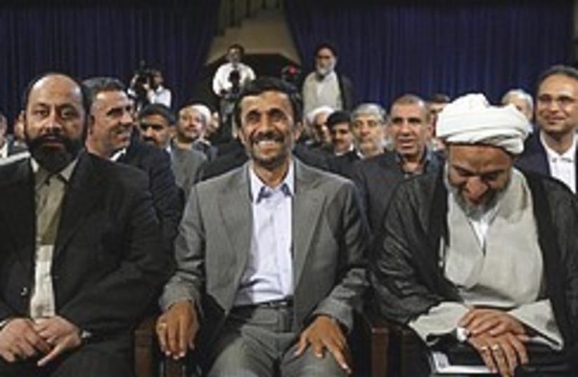 Ahmadinejad smiles with lawmakers 248.88 (photo credit: AP)