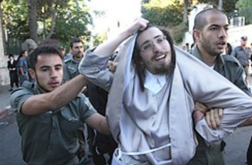 goofy haredi arrested 248.88 (photo credit: Ariel Jerozolimski)