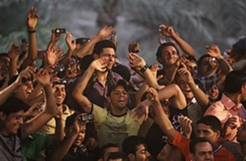 iraqi celebration 248.88 (photo credit: AP)