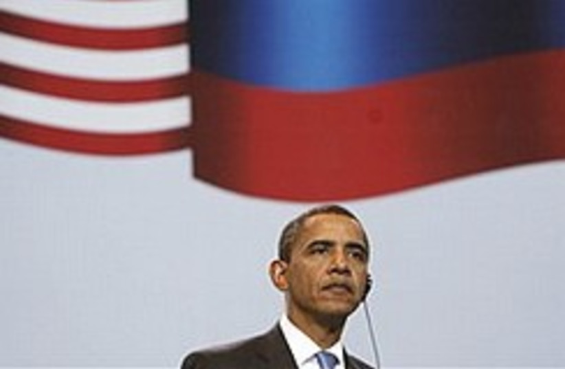 Obama russia flags 248.88 (photo credit: AP)