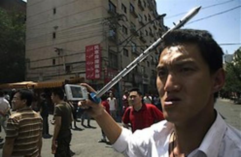 china Uighur urumqi riots 248 88 ap (photo credit: )