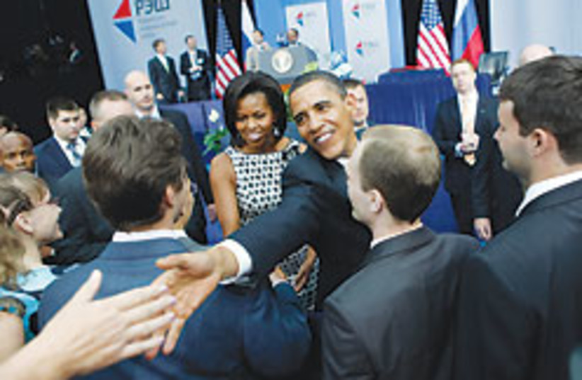 obama shakes hand 88 248 (photo credit: )